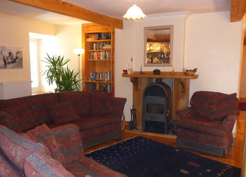 Guest lounge with wood burning stove
